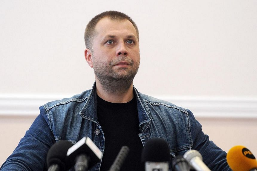 """Self-proclaimed Prime Minister of the pro-Russian separatist """"Donetsk People's Republic"""" Alexander Borodai gives a press conference in the eastern Ukrainian city of Donetsk, on July 20, 2014. -- PHOTO: AFP"""