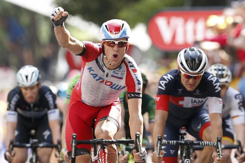 Katusha team rider Alexander Kristoff of Norway celebrates as he crosses the finish line to win the 222km 15th stage of the Tour de France cycling race between Tallard and Nimes on July 20, 2014. -- PHOTO: REUTERS