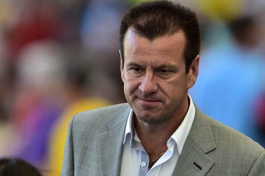Rumours that Brazil will give former skipper Dunga (above) a second stint as national coach reached deafening levels on Sunday with Globo reporting he is about to be unveiled as Luiz Felipe Scolari's successor. -- PHOTO: AFP