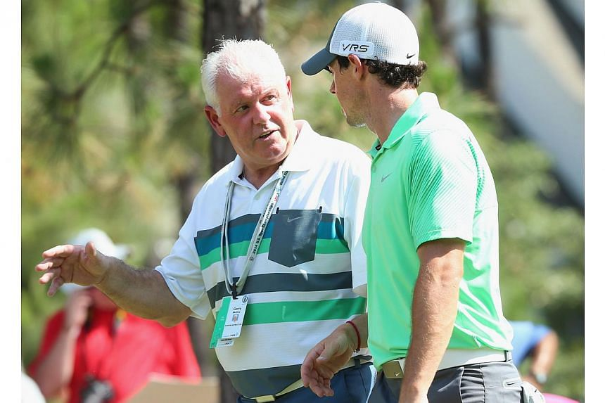 Gerry McIlroy (right) was £100,000 (S$212,000) richer on Sunday following his son Rory's two-stroke victory in the 143rd British Open at Royal Liverpool. -- PHOTO: AFP