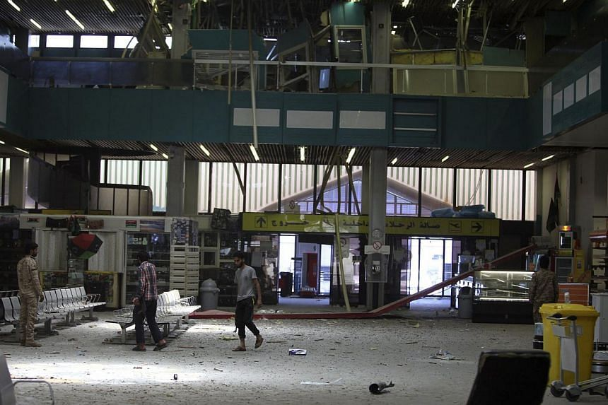 The inside of a damaged terminal is seen after a shelling at Tripoli International Airport on July 17, 2014. -- PHOTO: REUTERS
