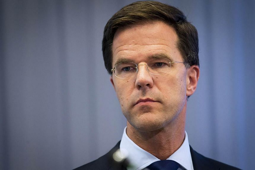 Dutch Prime Minister Mark Rutte gives a press conference at the Ministry of Safety and Justice in The Hague, on July 18, 2014, a day after an aircraft of Malaysia Airlines crashed in eastern Ukraine. -- PHOTO: AFP