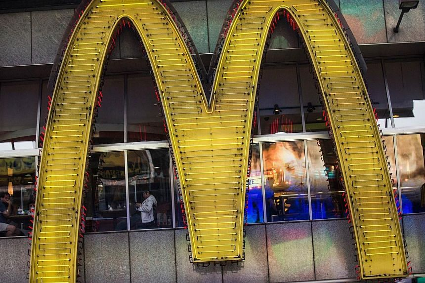 A sign for a McDonald's restaurant is seen in Times Square on June 9, 2014 in New York City.US fast food chains McDonald's Corp and Yum! Brands Inc said they will stop using products supplied by a local meat processor after a Shanghai regulator