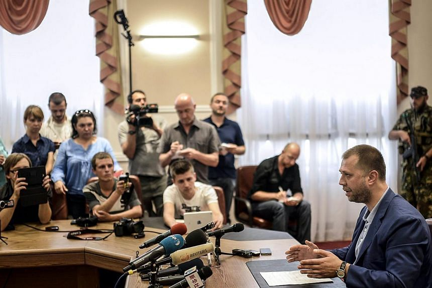 """Self-proclaimed Prime Minister of the pro-Russian separatist """"Donetsk People's Republic"""" Alexander Borodai gives a press-conference in the eastern Ukrainian city of Donetsk, on July 19, 2014.-- PHOTO: AFP"""