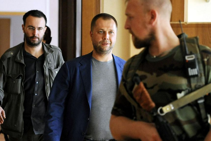 """Self-proclaimed Prime Minister of the pro-Russian separatist """"Donetsk People's Republic"""" Alexander Borodai walks to his press-conference Donetsk on July 18, 2014.-- PHOTO: AFP"""