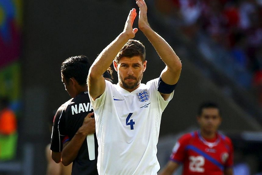 England's Steven Gerrard applauds at the end of their 2014 World Cup Group D soccer match against Costa Rica at the Mineirao stadium in Belo Horizonte on June 24, 2014. England captain Steven Gerrard announced his retirement from international f