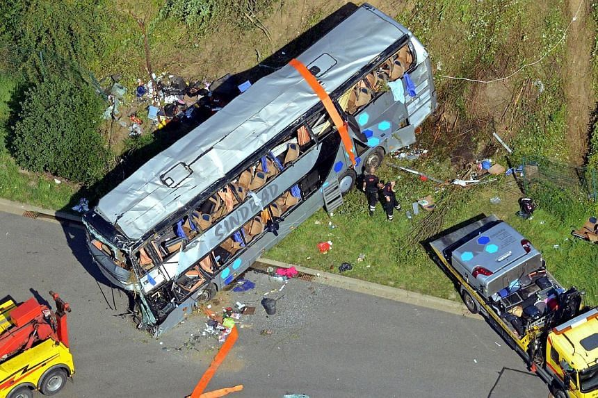 Aerial view shows the accident site of a bus crash on the A4 motorway linking Poland and Germany near the Neustadt district in Dresden, eastern Germany, on July 19, 2014.The death toll from the crash climbed to 11 on Monday, July 21, after anot
