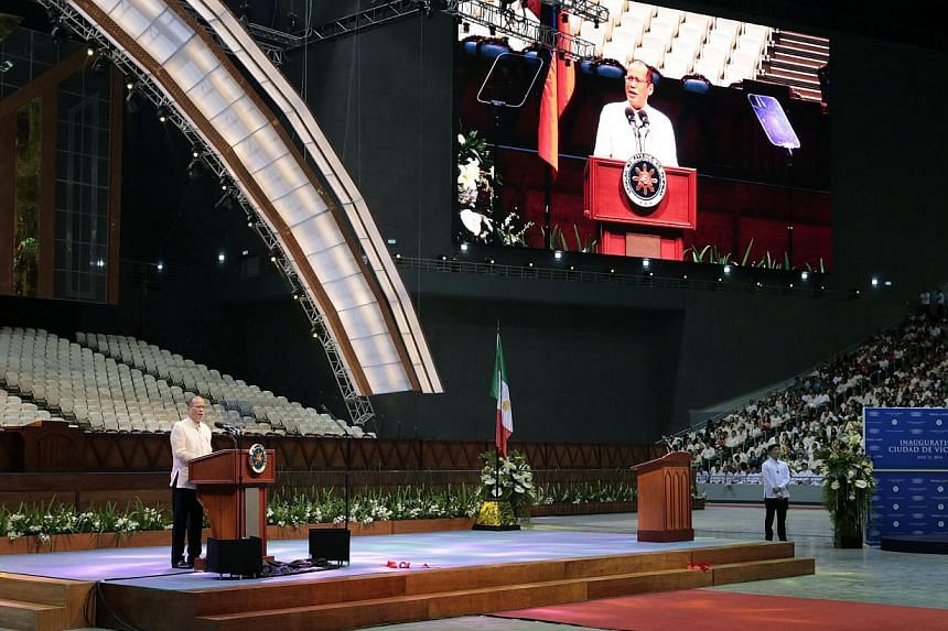 Philippine President Benigno Aquino presides over the opening of the Philippine Arena, the world's largest indoor stadium erected by politically-influential religious sect Iglesia ni Cristo (Church of Christ) in Bulacan, north of Manila, on July 21,