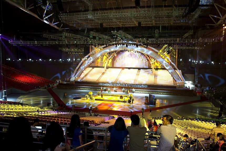 Members of Iglesia niCristo (Church of Christ) are seen inside the newly built dome in Bocaue, Bulacan, north of Manila, on July 20, 2014.-- PHOTO: AFP