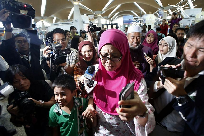 A Malaysian family arrives to confirm the news that their relatives were on board the Malaysian Airlines MH17 at the Kuala Lumpur International Airport in Sepang on July 18, 2014.Malaysia Airlines said it will provide US$5,000 (S$ 6,200) to eac