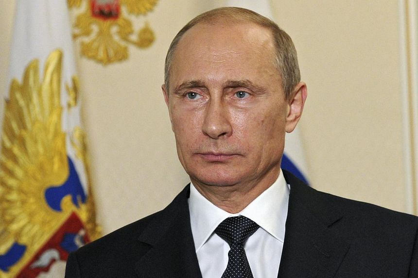 Russian President Vladimir Putin makes a televised statement at the Novo-Ogaryovo state residence outside Moscow, in the early hours of July 21, 2014.Russian President Vladimir Putin said on Monday the downing of a Malaysian airliner in east Uk