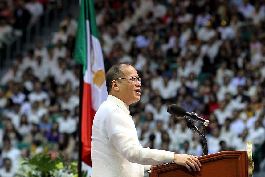 Philippine President Benigno Aquino delivers his speech during the opening ceremony of world's largest indoor stadium, erected by a politically-influential religious sect Iglesia ni Cristo (Church of Christ) in Bocaue town, Bulacan province, north of