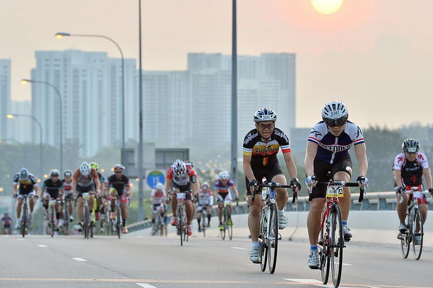 Cyclists cycling up Benjamin Sheares Bridge at the sixth edition of the OCBC Cycle Singapore at the F1 Pit Building on 30 March 2014. OCBC Bank is on the hunt for a new event organiser to run next year's OCBC Cycle in Singapore and Malaysia, in a bid