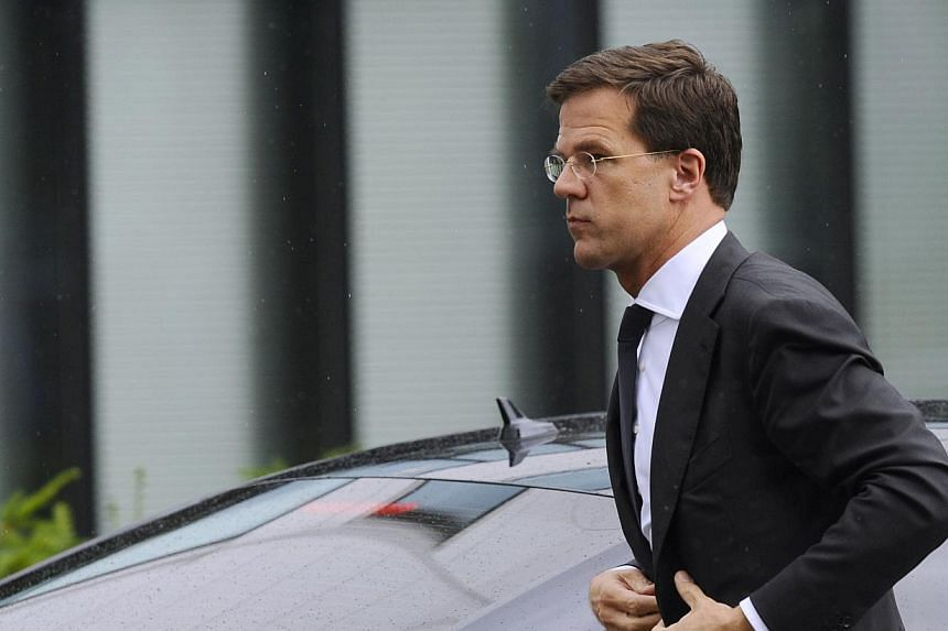 Dutch Prime minister Mark Rutte arrives to meet the families of the victims of the plane crash on July 21, 2014, in Utrecht.The Dutch public prosecutor's office said Monday it had opened a preliminary criminal probe into the downing of flight M