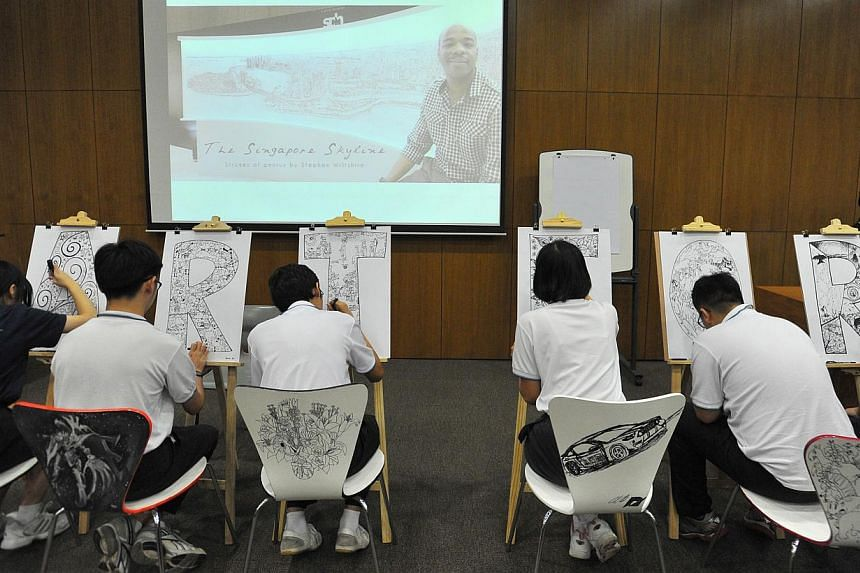 Students from Pathlight School's Artist Development Program doing their sketches together with Stephen Wiltshire during his visit to Pathlight School on July 21, 2014. -- ST PHOTO: LIM YAOHUI FOR THE STRAITS TIMES