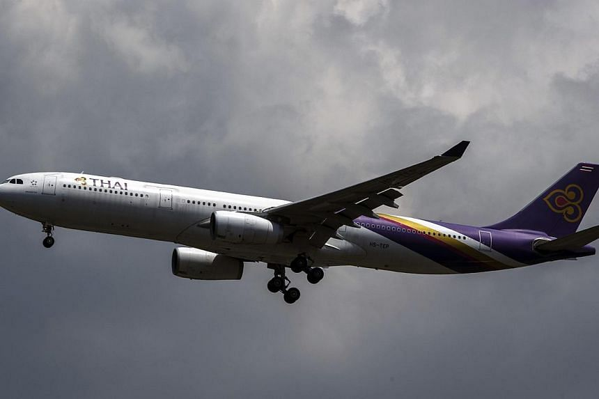 A Thai Airways plane prepares to land at Bangkok's Suvarnabhumi Airport on July 17, 2014. -- PHOTO: REUTERS