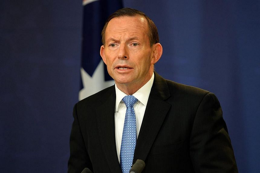 Australian Prime Minister Tony Abbott speaks at a press conference in Sydney on July 19, 2014.Evidence at the crash site of Malaysia Airlines MH17 has been tampered with on an industrial scale as part of an apparent cover-up attempt, Mr Abbott