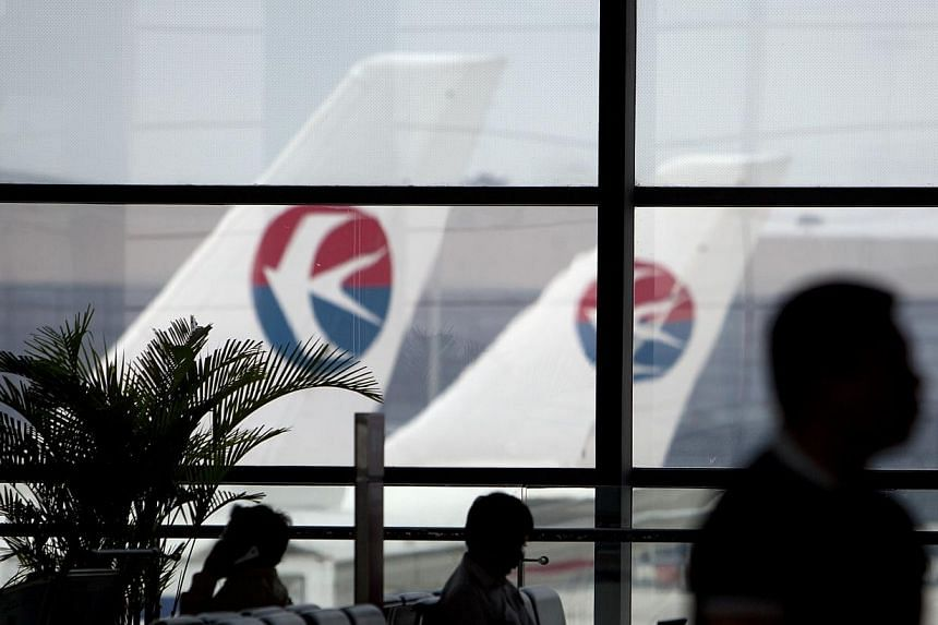 "Airlines have been ordered to cut a quarter of their flights at a dozen Chinese airports to accommodate four weeks of ""high frequency exercises"" state media has reported. -- PHOTO: BLOOMBERG"