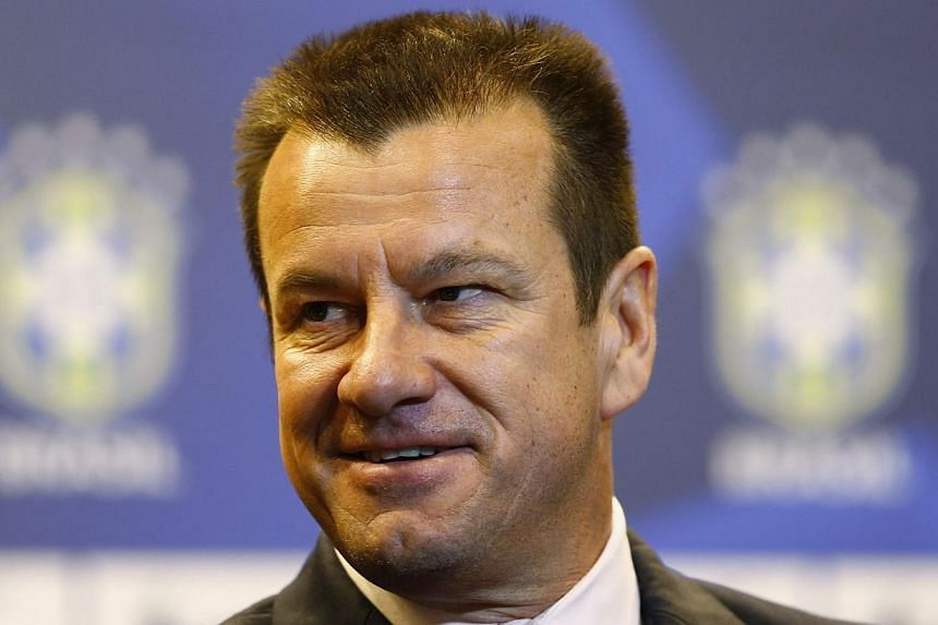 Brazil's new manager Dunga arrives at a news conference in Rio de Janeiro on July 22, 2014.Dunga won the World Cup as a player for Brazil and now the country is giving him a second chance to get the trophy as a coach. -- PHOTO: REUTERS