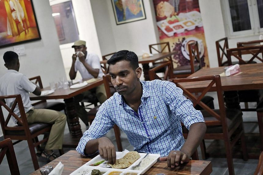 Customers eat inside a restaurant run by the Tihar Jail authorities on Jail Road in west Delhi on July 21, 2014. -- PHOTO: REUTERS