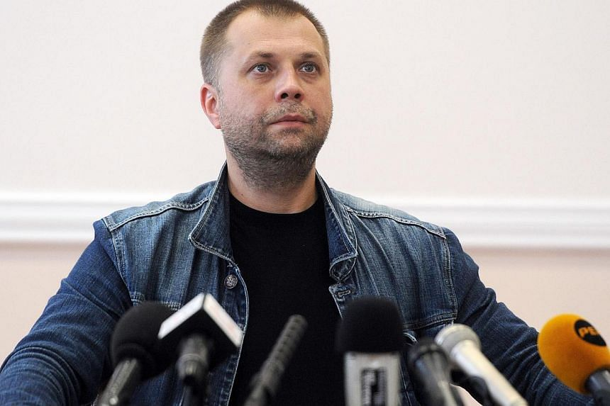 """Self-proclaimed Prime Minister of the pro-Russian separatist """"Donetsk People's Republic"""" AleksanderBorodai gives a press conference in the eastern Ukrainian city of Donetsk, on July 20, 2014. -- PHOTO: AFP"""