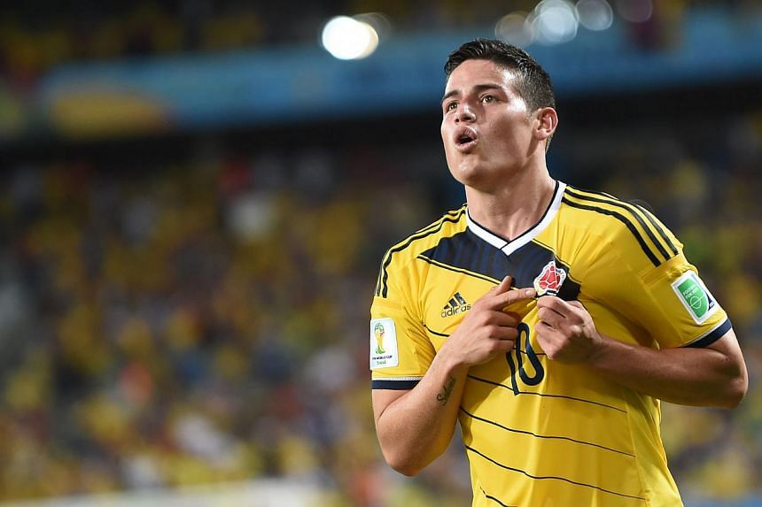 Colombia's midfielder James Rodriguez celebrates after scoring Colombia's fourth goal during the Group C football match between Japan and Colombia at the Pantanal Arena in Cuiaba during the 2014 FIFA World Cup on June 24, 2014. -- PHOTO: AFP