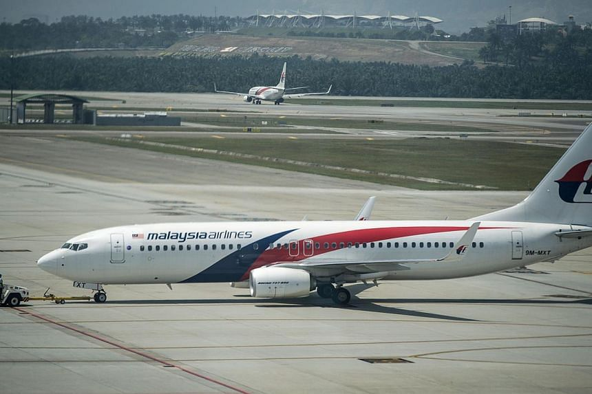 A Malaysia Airlines plane is seen on the tarmac at Kuala Lumpur International Airport in Sepang on July 21, 2014. -- PHOTO: AFP
