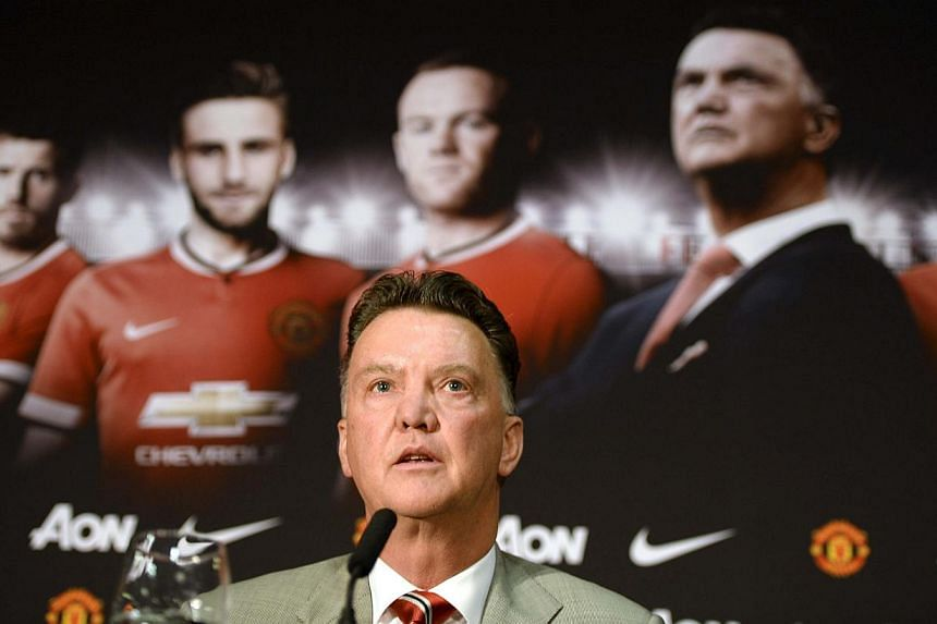 New Manchester United manager Louis Van Gaal speaks to the media during a news conference at the club's Old Trafford Stadium in Manchester, northern England, on July 17, 2014. -- PHOTO: REUTERS