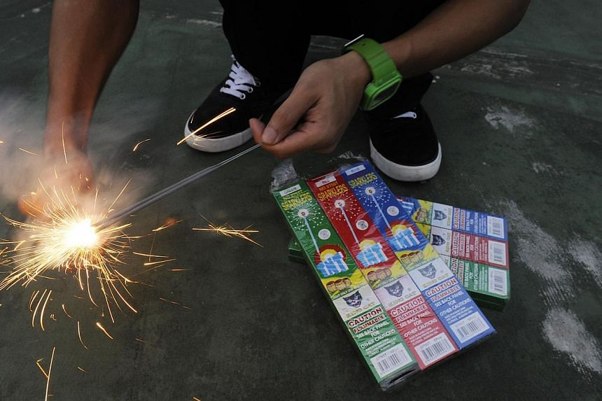 Ahead of the festive season, the police have reminded the public that they take a serious view of setting off improvised explosive devices made with sparklers. -- PHOTO: ST FILE