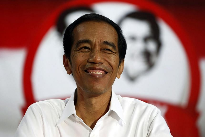 Jakarta governor Joko Widodo has won the Indonesian presidential election with 53 per cent of the vote against about 47 per cent for ex-general Prabowo Subianto, according to a tally of final results cited by local media on July 22, 2014. -- PHOTO: R