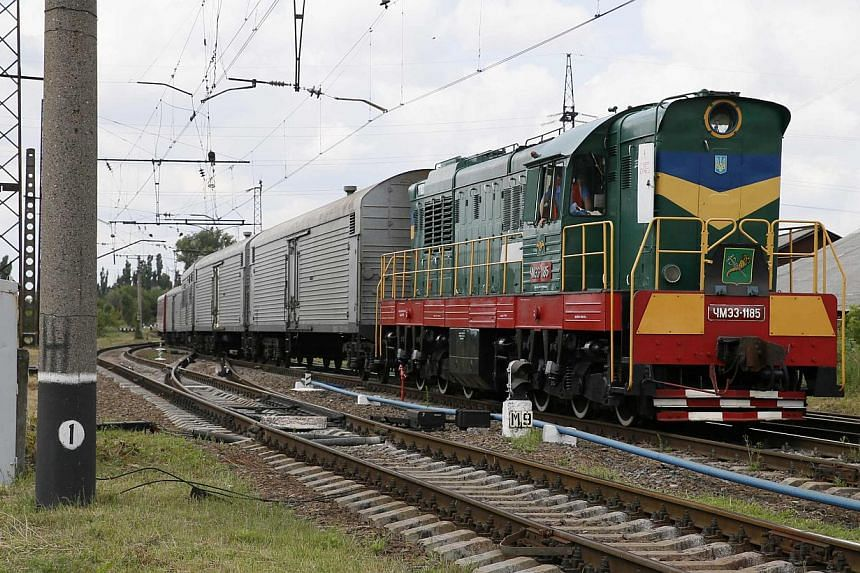 A train carrying the remains of the victims of Malaysia Airlines MH17 downed over rebel-held territory in eastern Ukraine arrives in the city of Kharkiv in eastern Ukraine on July 22, 2014.The first bodies from the MH17 crash in Ukraine will be