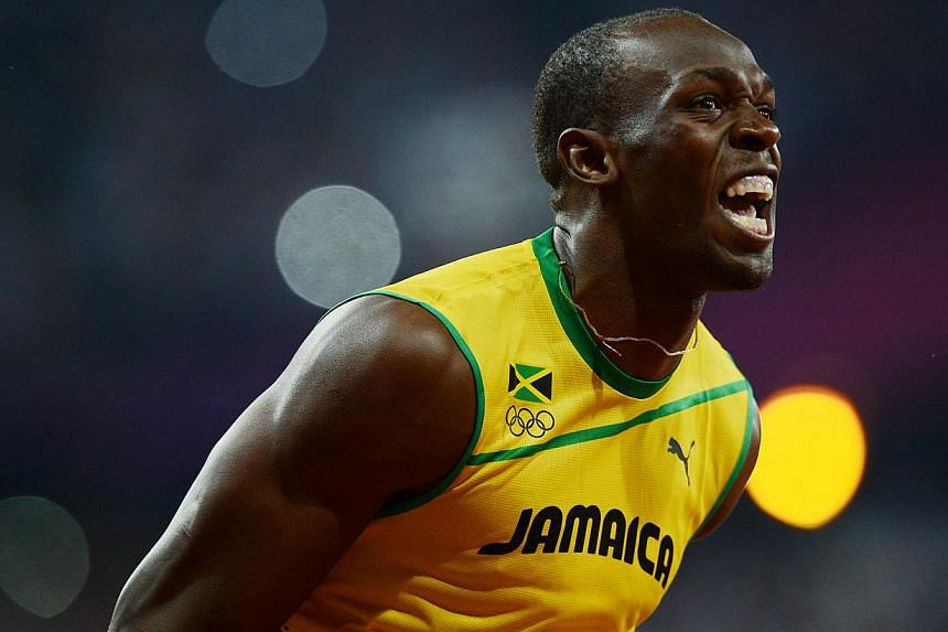 Usain Bolt reacts as he wins the men's 200m gold medal at the London 2012 Olympic Games. -- PHOTO: ST FILE