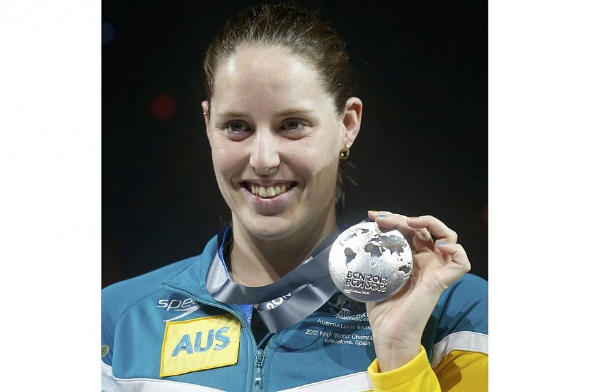 Australia's Alicia Coutts poses with her silver medal at the women's 100m butterfly victory ceremony during the World Swimming Championships at the Sant Jordi arena in Barcelona July 29, 2013. -- PHOTO: REUTERS