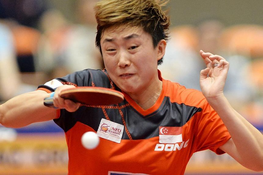 Singapore's Feng Tianwei hits a return against Japan's Kasumi Ishikawa during their women's singles final at the Japan Open table tennis tournament in Yokohama on June 22, 2014. -- PHOTO: AFP
