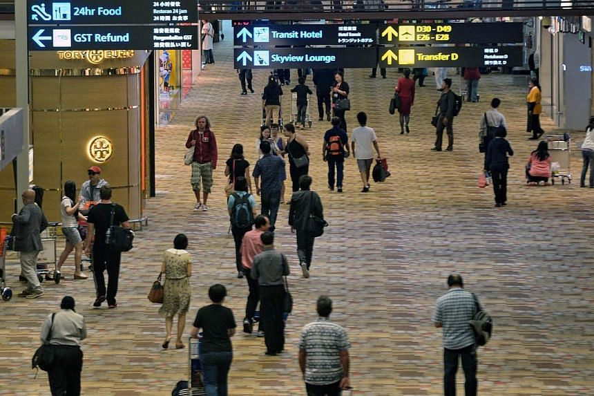 Changi Airport handled 4.65 million passengers in June, the highest for any month so far this year, but lower than a year ago. -- PHOTO: AFP