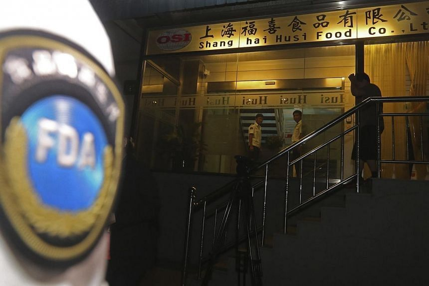 Officers from Shanghai Food and Drug Administration conduct a seizure at Husi Food factory in Shanghai on July 20, 2014. Chinese police on Wednesday, July 23, 2014, detained five people from a unit of US food supplier OSI Group, officers said, i