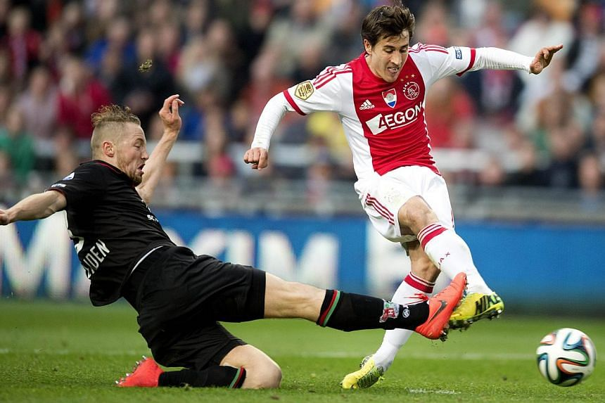 Ajax player Bojan Krkic (right) kicks the ball to score his team's second goal during the Dutch Eredivisie football match between Ajax Amsterdam and NEC Nijmegen, in Amsterdam, the Netherlands, on May 3, 2014. -- PHOTO: AFP