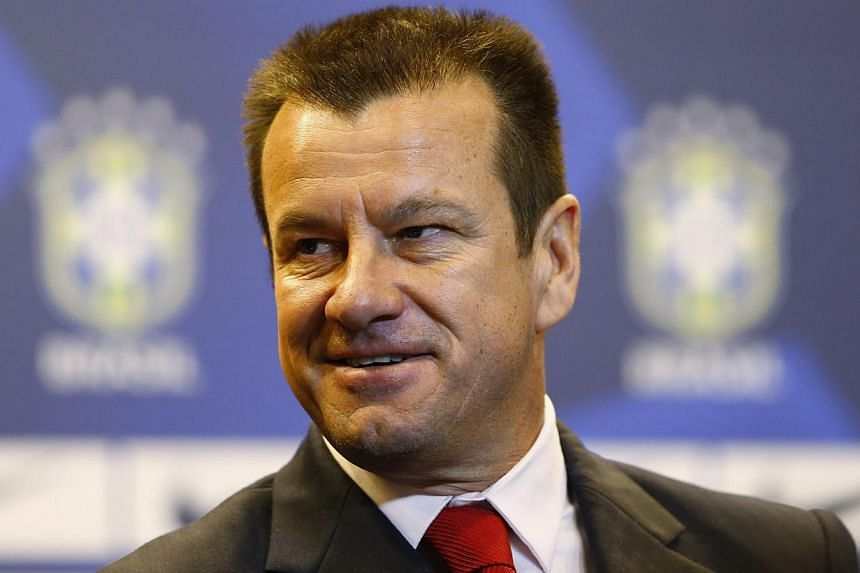 Brazil's new manager Dunga arrives at a news conference in Rio de Janeiro on July 22, 2014. -- PHOTO: REUTERS