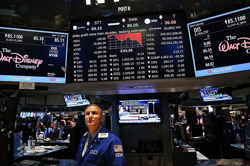 Traders work on the floor of the New York Stock Exchange (NYSE) in New York City on July 17, 2014. Computer systems containing the Wall Street Journal's news graphics were hacked by outside parties, according to the paper's publisher Dow Jones &