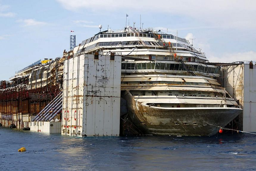 The Costa Concordia cruise liner is seen during its refloat operation at Giglio harbour on July 22, 2014. -- PHOTO: REUTERS