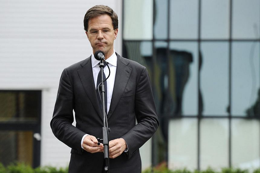 Dutch Prime minister Mark Rutte speaks after meeting relatives of victims of the Malaysia airlines plane crash in Utrecht on July 21, 2014. -- PHOTO: AFP