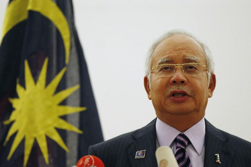 Malaysian Prime Minister Najib Razak speaks at a news conference where he announced that two black boxes from downed Malaysia Airlines flight MH17 will be handed over to Malaysia by Ukrainian rebels, in Kuala Lumpur on July 22, 2014. -- PHOTO: REUTER