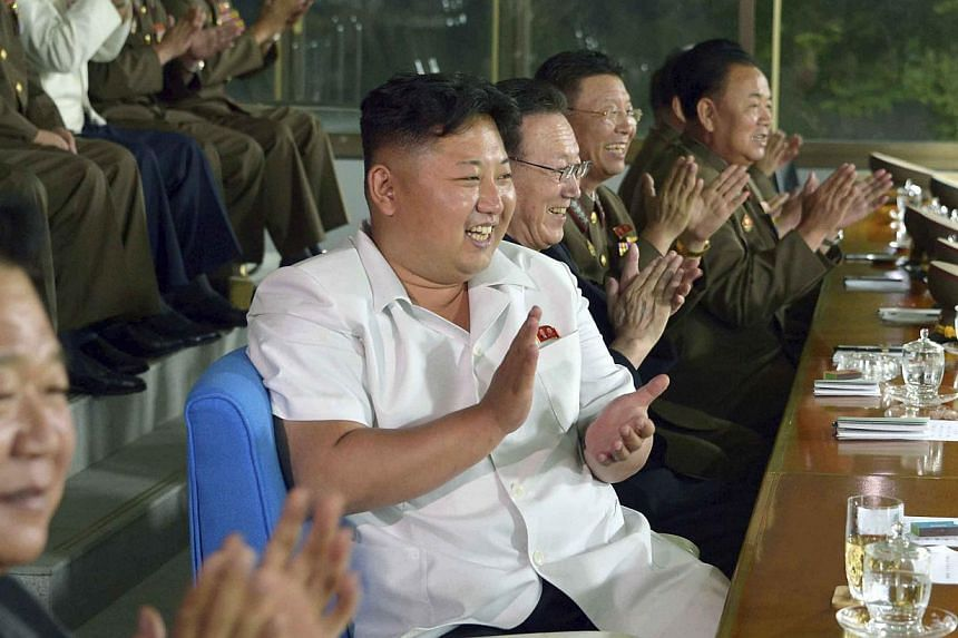 North Korean leader Kim Jong Un watches a match played by the North Korean men's national soccer team, which will take part in the 17th Asian Games, in this undated photo released by North Korea's Korean Central News Agency (KCNA) in Pyongyang on Jul