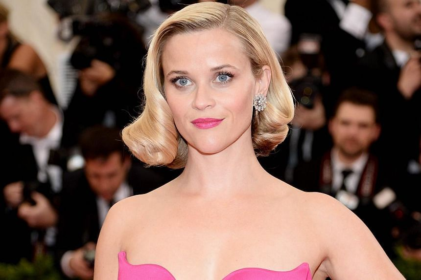 """Reese Witherspoon attends the """"Charles James: Beyond Fashion"""" Costume Institute Gala at the Metropolitan Museum of Art in New York City on May 5, 2014. -- PHOTO: AFP"""