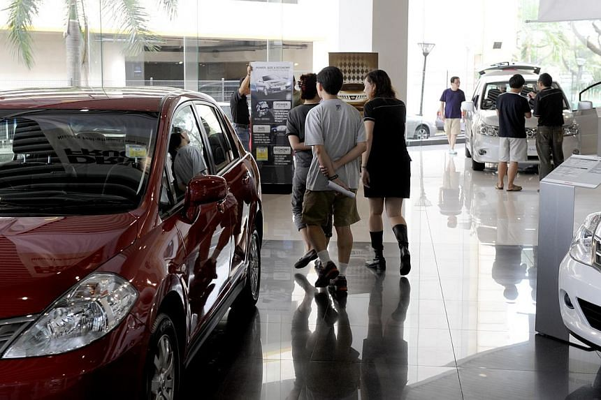 A smaller rise in car prices helped lower Singapore's inflation rate to 1.8 per cent last month from 2.7 per cent in May, data from the Singapore Department of Statistics showed on Wednesday. -- PHOTO: ST FILE