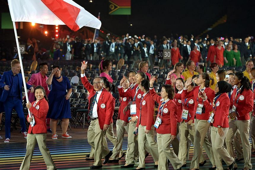 Members of the Singapore delegation walk past during the opening ceremony of the 2014 Commonwealth Games at Celtic Park in Glasgow on July 23, 2014. -- ST PHOTO: KUA CHEE SIONG