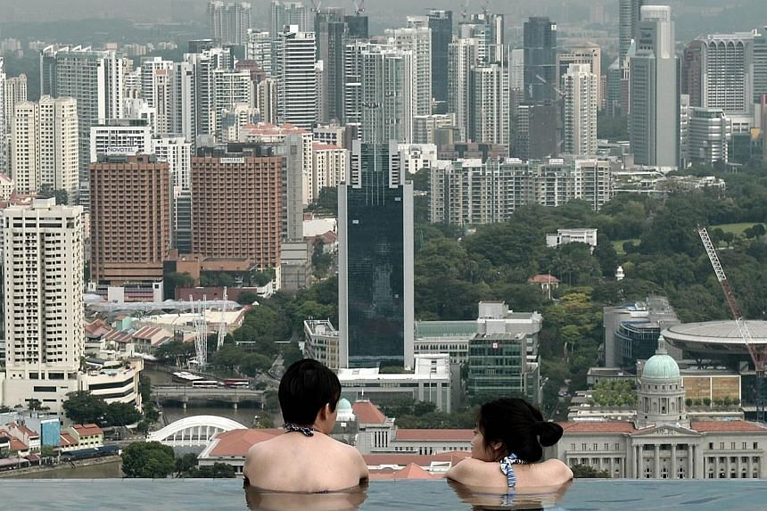 The number of billionaires in Singapore has risen to 26 from 21 a year ago, while the total wealth of the country's richest has also shot up, according to the latest data released by Forbes magazine on Thursday. -- PHOTO: AFP