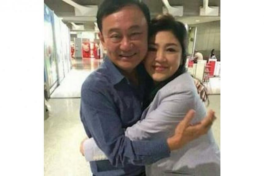 Former Thai prime minister Yingluck Shinawatra on Thursday reunited with her brother Thaksin Shinawatra, in Paris, Thai media reported. -- PHOTO: I'NAM MATICHON/TWITTER
