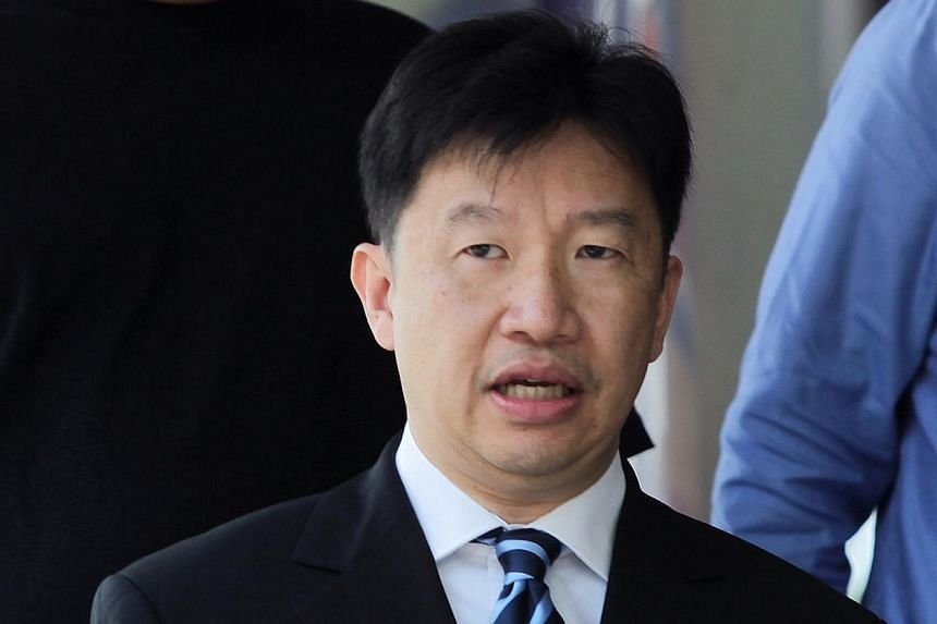 Mark Edward Tjong, 48, theformer business director of a subsidiary of ST Electronics, leaves the court on July 24, 2014. -- ST PHOTO: NEO XIAOBIN