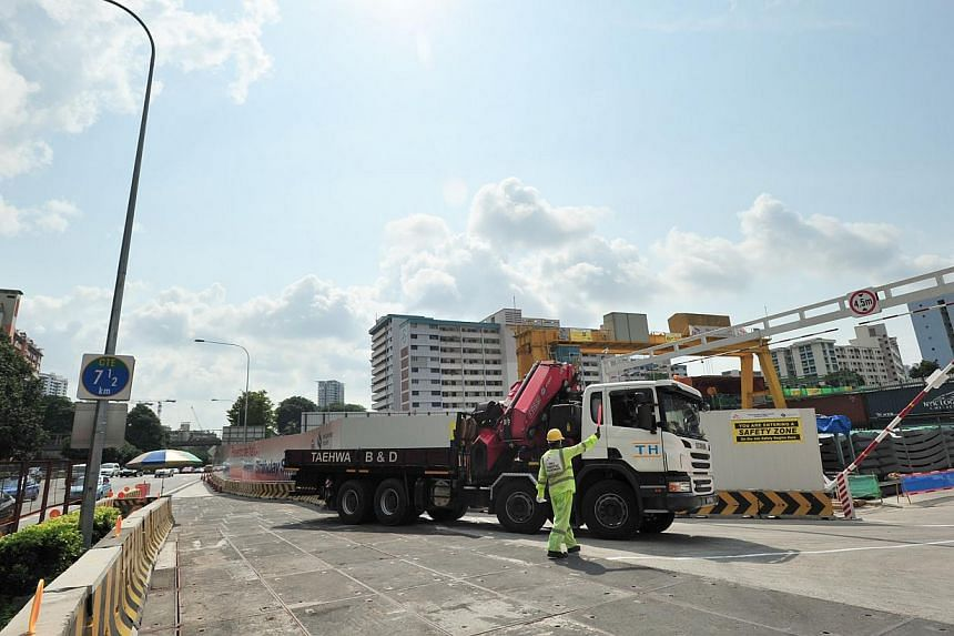 A traffic marshal directing a lorry along the special access road off the Central Expressway. -- ST PHOTO: STEFFI KOH